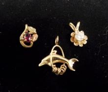VINTAGE LOT OF 3 10K - 14K GOLD PENDANTS - DOLPHIN THROUGH HOOP, TRICOLOR WITH GARNET LEAF DESIGN AND FLOWER WITH GENUINE DIAMOND CENTER