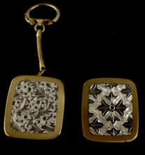 VINTAGE CLOVER MUSIC BOX KEY CHAINS LOT OF 2 - ONE MISSING KEY RING THE OTHER IS MISSING WIND UP RING, BOTH WORK AND PLAY MUSIC