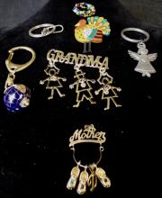 GRAB BAG OF MISC. PINS AND KEYCHAINS AND PENDANT WEIGHS 2 OZ