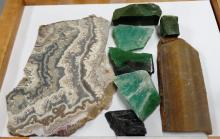 MIXED 11 OUNCE LOT OF CUT STOMES - EXACT ORIGINS UNKNOWN FOUND BY LOCAL ROCKHOUD (LARGEST MEASURES 5.75