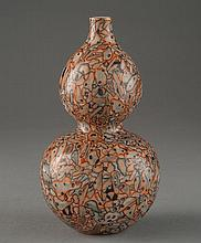 A FAMILL-ROSE DOUBLE-GOURD VASE