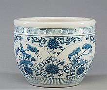 A BLUE AND WHITE FLOWER JAR