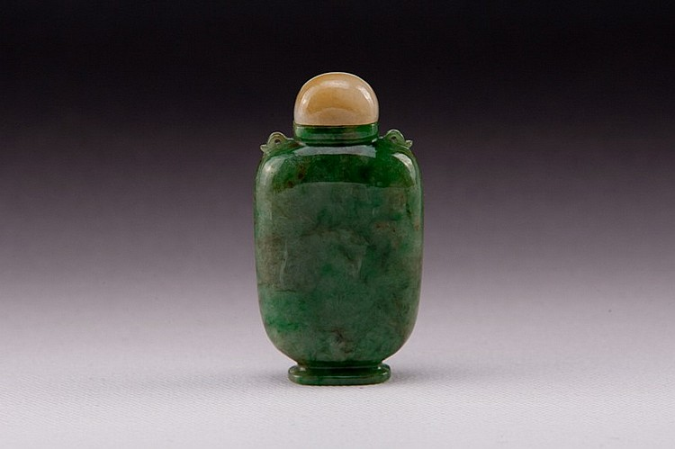 A carved jadeite snuff bottle