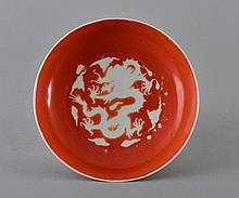 A CORAL-GROUND INCISED 'DRAGON' DISH