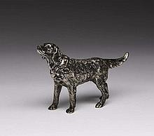 CONTINENTAL CAST SILVER MODEL OF A DOG