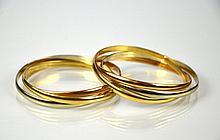 TWO TRI COLOURED GOLD ROLLING BANGLE BRACELET