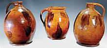 Redware - two ovoid jugs and a pot