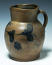 Redware pitcher, 9 1/2