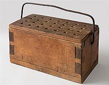 Footwarmer in wooden box