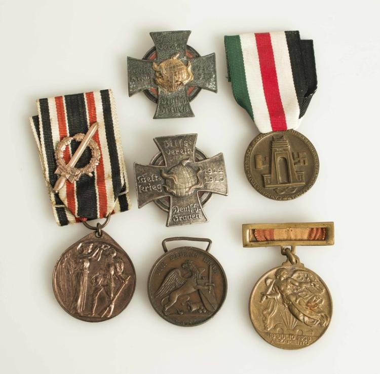 Penis shaped wwii medal