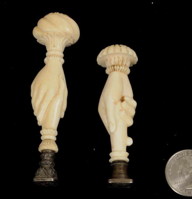 Two Continental Carved Ivory Hand Form Seals