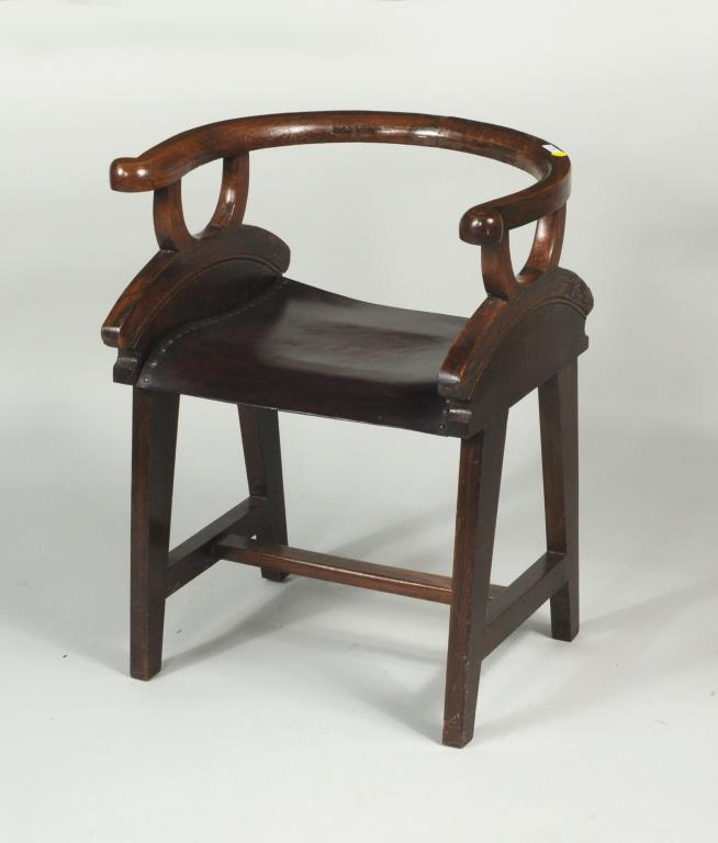 Low Back Arm Chair of Unusual Form