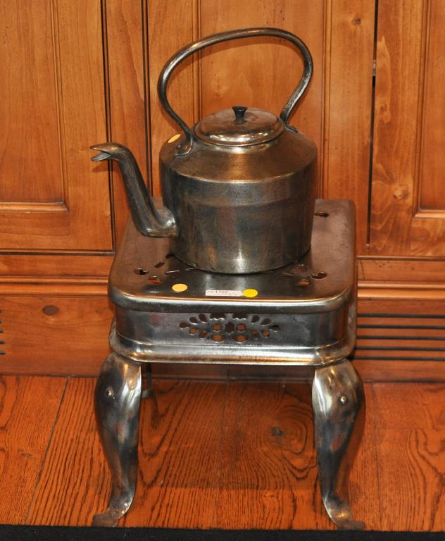 A Steel Teapot & Pierce Decorated Footman