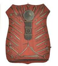 Red Cloth Covered Wood Shield with Attached Small Edge Weapons