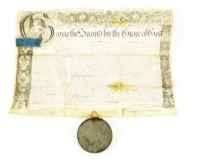 English Letters Patent Issued by King George II in 1749 on Vellum with attached wax seal in tin case