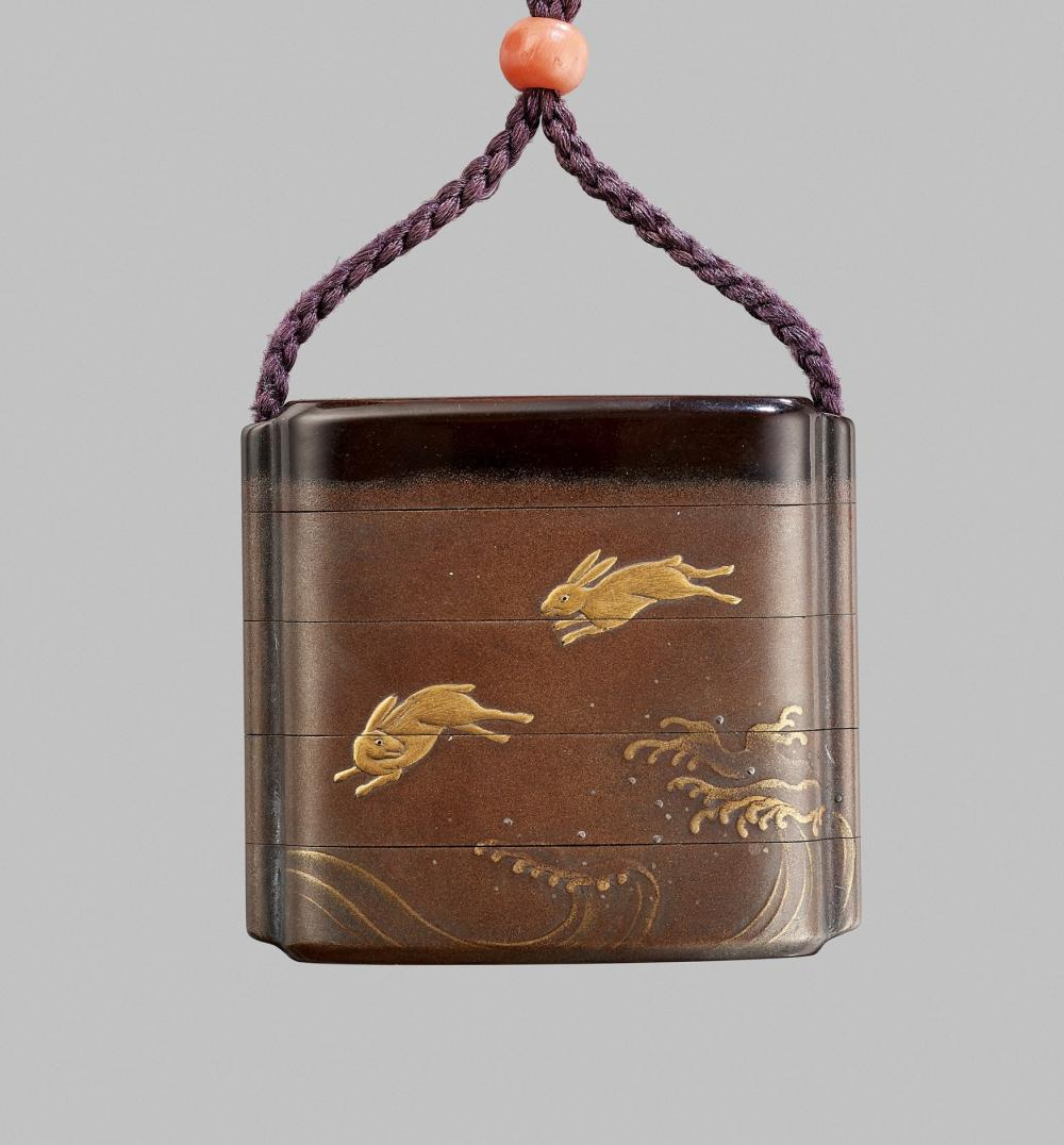 A RARE GILT-INLAID LACQUER FOUR-CASE INRO WITH LUNAR HARES, MOON, AND BENTEN