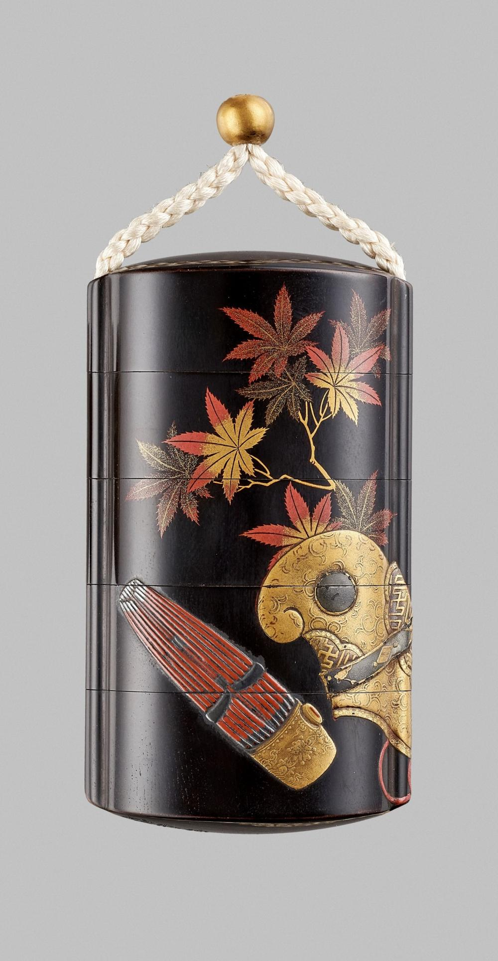 JOKASAI: A BLACK LACQUER FOUR-CASE INRO WITH MAPLE LEAVES AND BUGAKU ACCOUTREMENTS