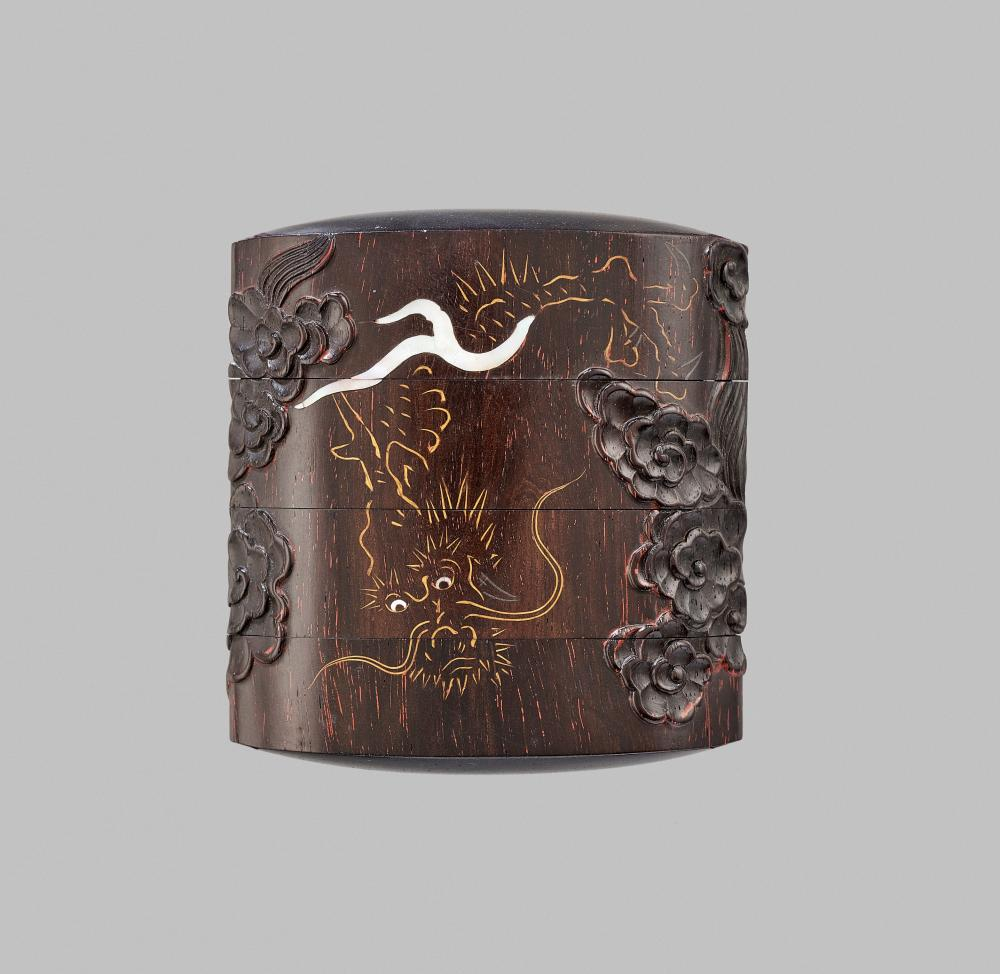 AN UNUSUAL INLAID LACQUER THREE-CASE INRO DEPICTING A DRAGON AMID CLOUDS