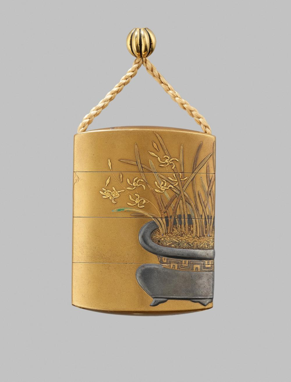 KAJIKAWA: A FINE GOLD LACQUER THREE-CASE INRO WITH A FLOWERPOT AND BUTTERFLIES