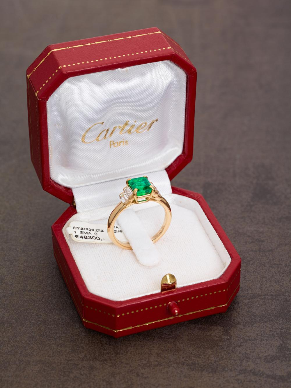 AN IMPORTANT CARTIER EMERALD AND DIAMOND RING