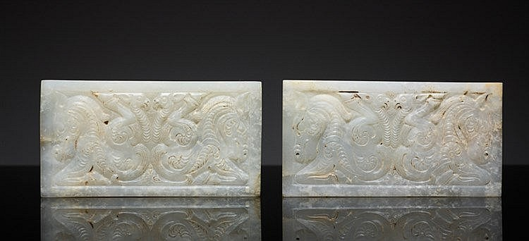 PAIR OF PLAQUES IN WHITE JADE IN THE STYLE OF THE STEPPE