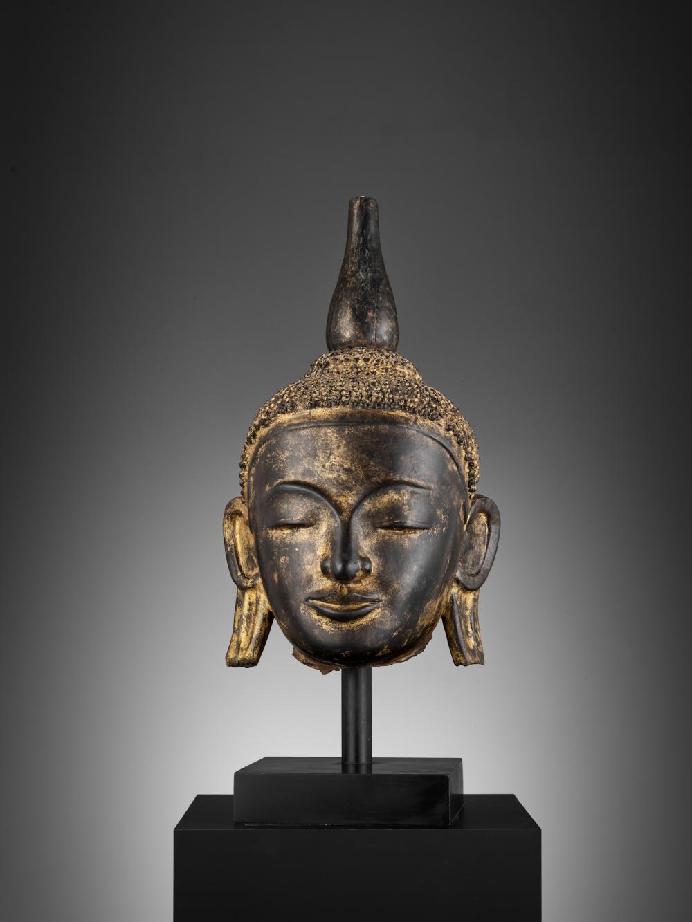 A LARGE GILT BUDDHA HEAD, AVA STYLE