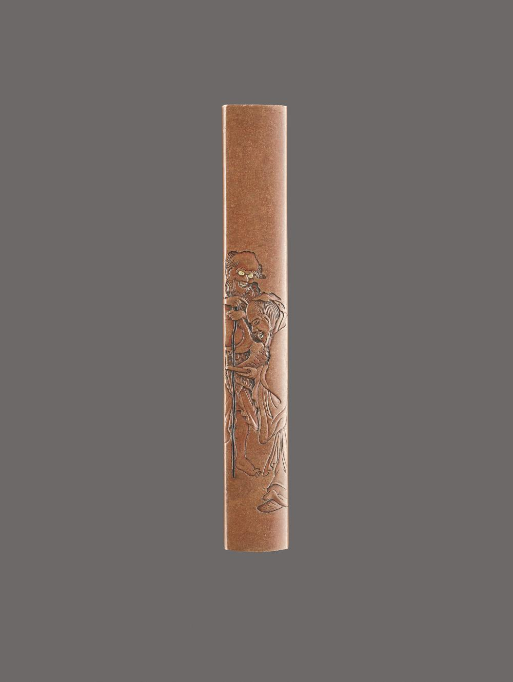 A COPPER KOZUKA HANDLE OF TWO IMMORTALS BY NAOYUKI