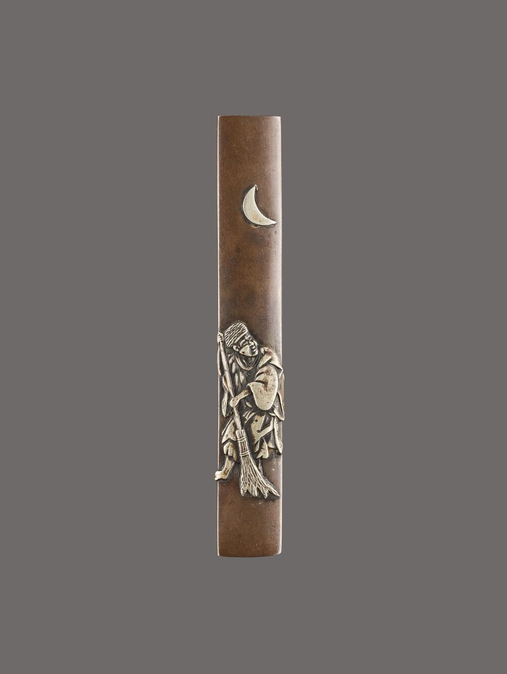 A SENTOKU AND SILVER KOZUKA HANDLE DEPICTING A MAN WITH A BROOM UNDER THE CRESCENT MOON