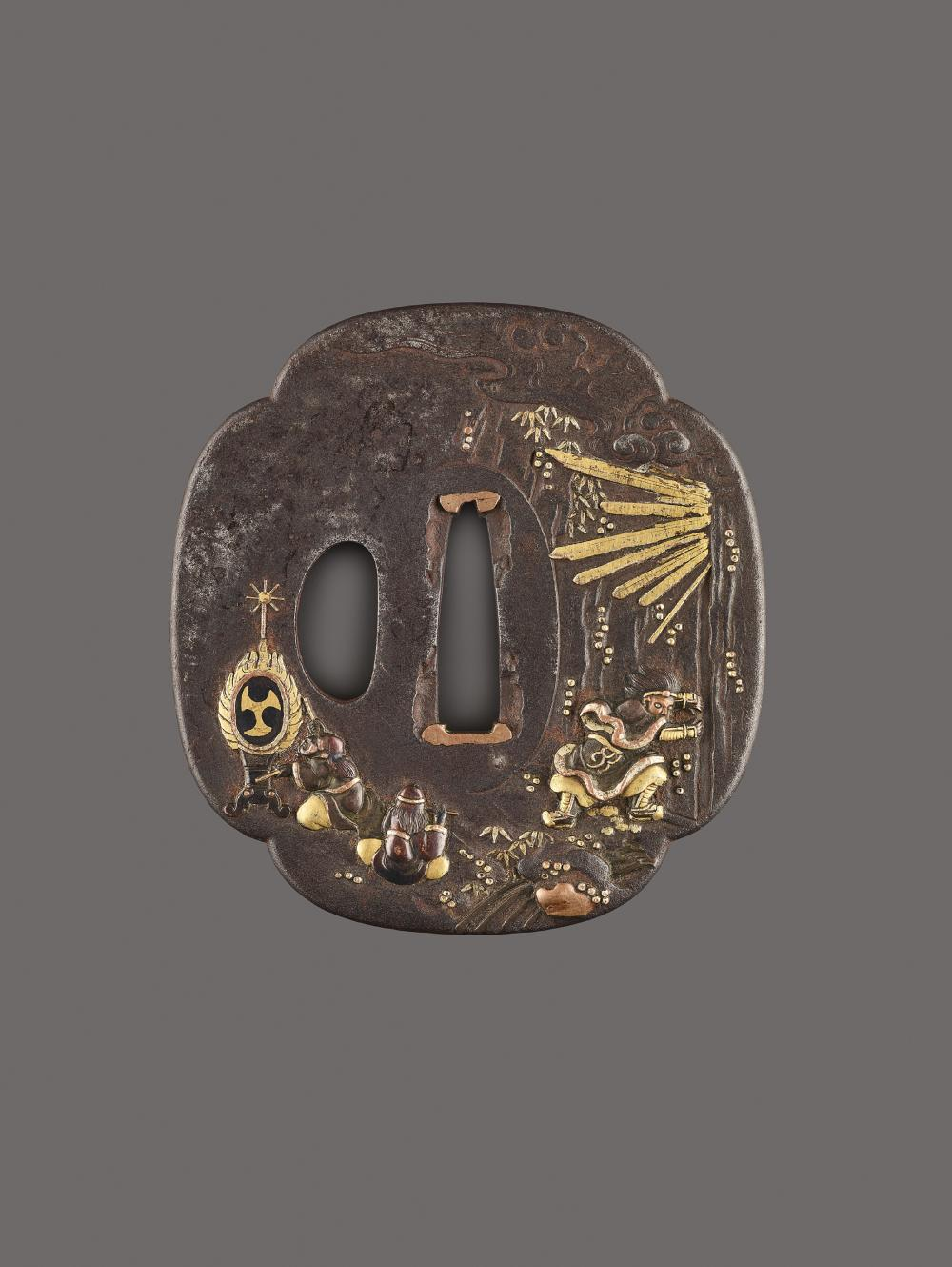 AN IRON, COPPER AND GOLD TSUBA DEPICTING FUDO AND COMPANION