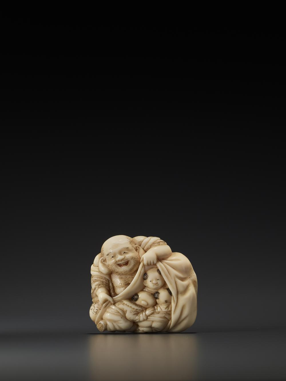 AN IVORY BROOCH OF HOTEI