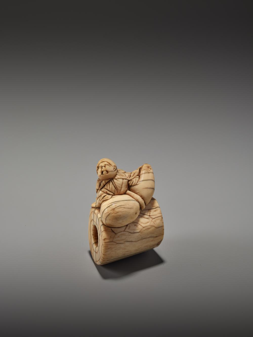 A RARE AND EARLY IVORY NETSUKE OF SENNIN WITH GIGANTIC GOURD