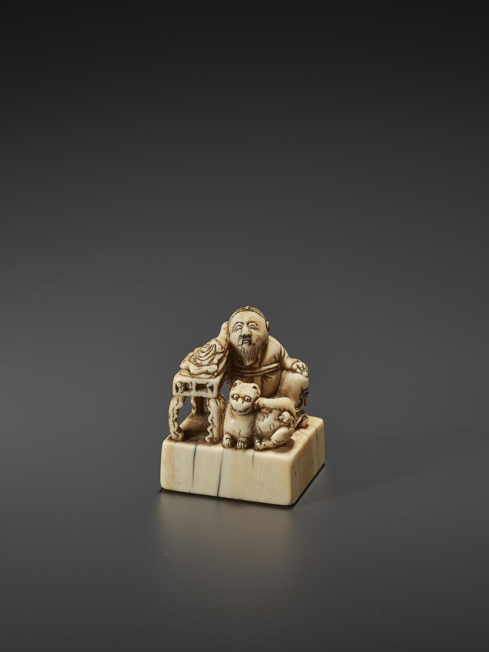 AN UNUSUAL AND EARLY IVORY NETSUKE OF A CHINESE SAGE WITH TIGER