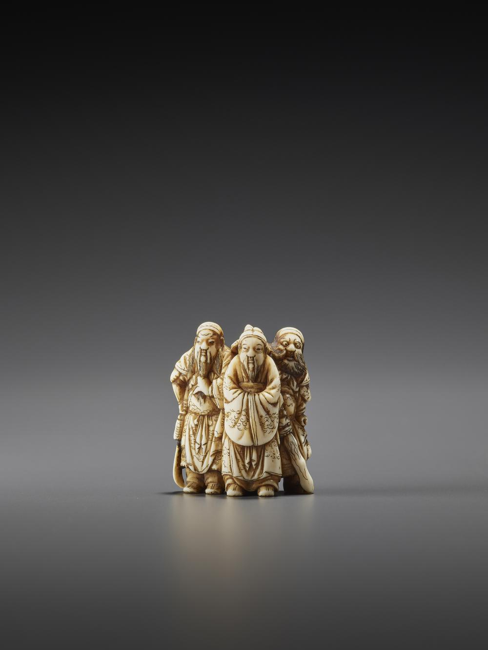 AN IVORY NETSUKE OF THE THREE HEROES OF THE HAN DYNASTY BY SEKIKO