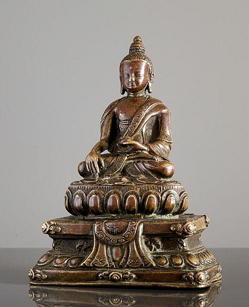 BUDDHA AKSHOBHYA SEATED ON A THRONE