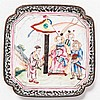 A SMALL ENAMEL PLATE WITH A THEATER SCENE