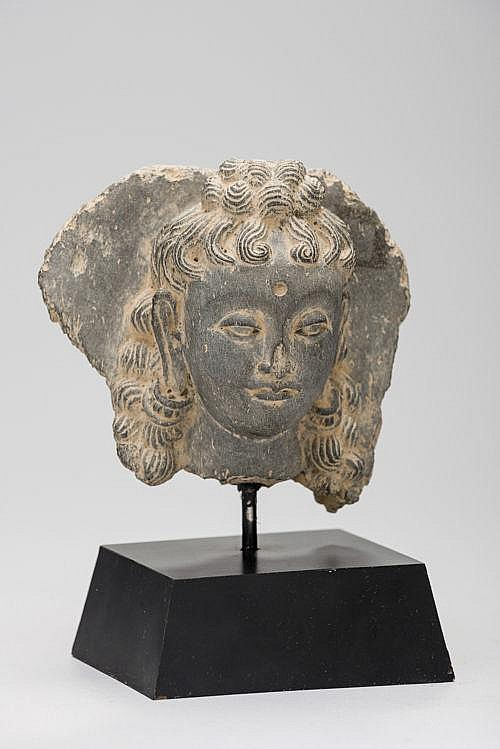A SLATE HEAD OF A JUVENILE BODDHISATTVA (BUDDHA)