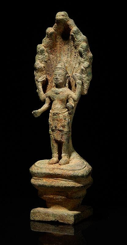 FOUR-ARMED LOKESHVARA UNDER NAGA SHIELD
