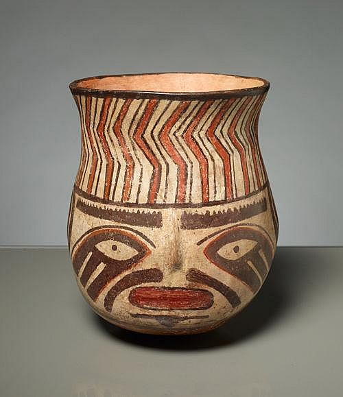 CUP WITH FACIAL DEPICTION