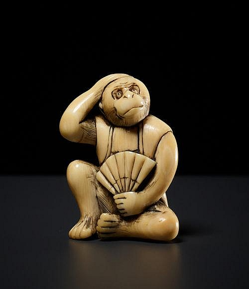 MONKEY WITH FOLDED FAN