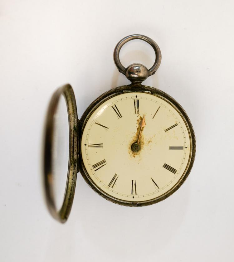 an antique sterling key wind pocket