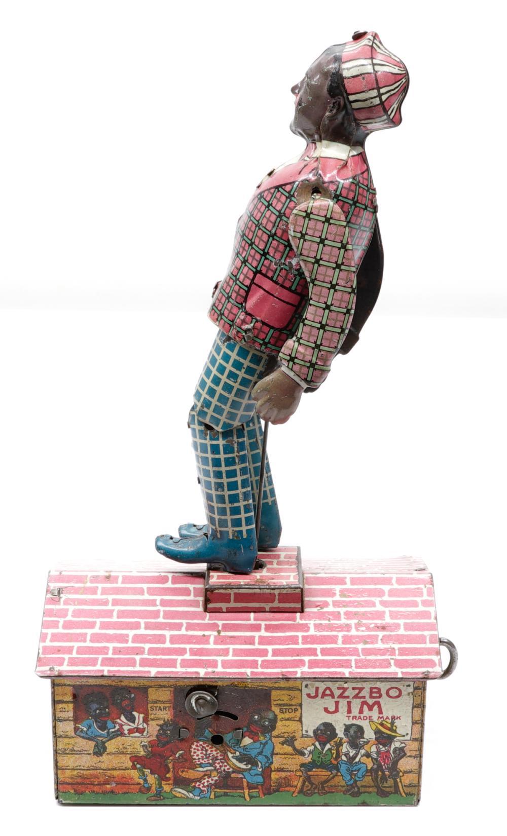 Lot 3: Jazzbo Jim Wind-Up Toy