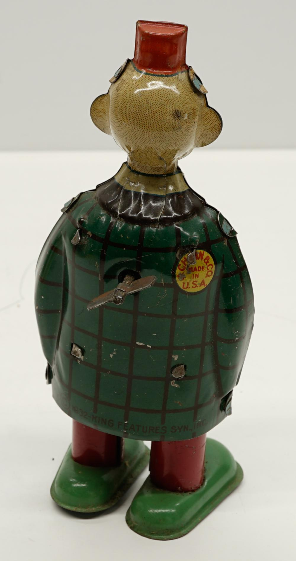 Lot 20: Chein Happy Hooligan Tin Wind-Up Toy