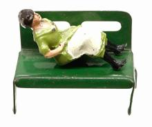 Lot 166: Lead Seated Figures with Bench (7)