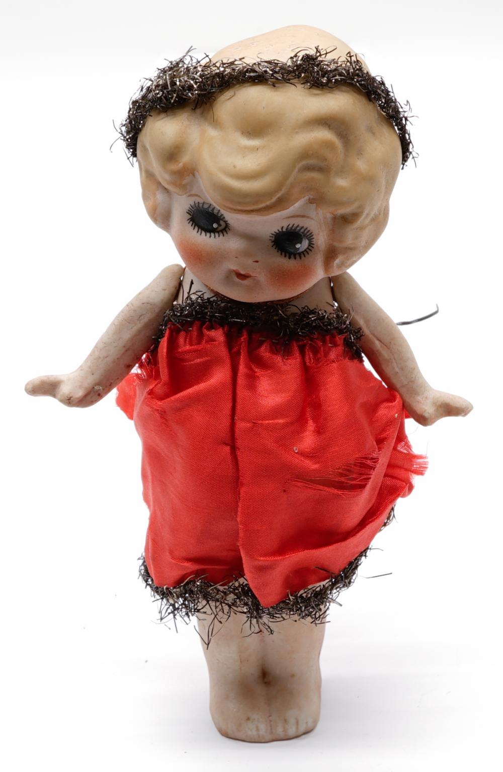 A Bisque Doll Measuring 6.25 in.