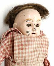 Lot 185: An Antique Metal Doll