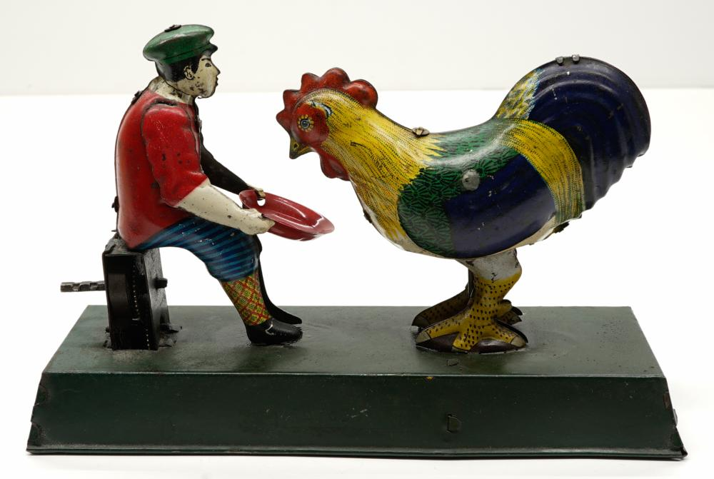 Lot 210: Pre-War Tin Japan Boy Feeding Chicken