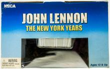 Lot 242: John Lennon 18 Inch Motion Activated Figure