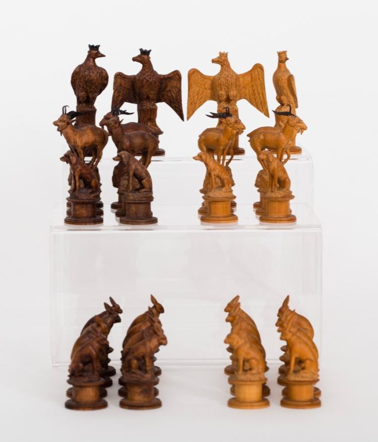 A Swiss Pearwood Animal and Bird Chess Set, 19th Century